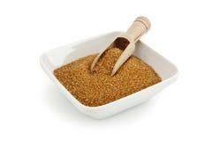 Wooden shovel in bowl of coarse sugar Royalty Free Stock Photos