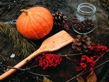 Wooden shovel cooking. Wood woodwork showel Cooking forest outdoor pepper cones Spruce kitchen pumpkin pumpkins Stock Photo