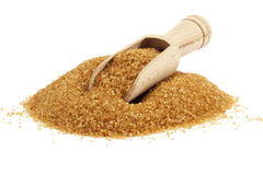 Wooden shovel on heap of brown sugar royalty free stock photography