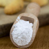 Wooden shovel with powdered sugar Royalty Free Stock Image