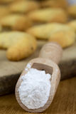 Wooden shovel with powdered sugar Royalty Free Stock Photography