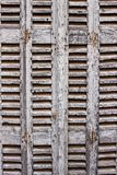 Shutter closed in grey from France. Wooden Shutter in grey with slatted finish Royalty Free Stock Photos