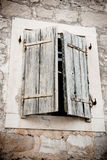 Wooden shutters. Blue vintage wooden shutters on stone wall Stock Images