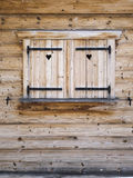 Wooden shutters on a cabin window Stock Photo