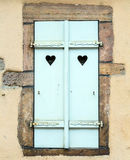 Wooden shutters with heart-shaped cutouts Stock Images