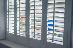 Wooden shutters with louvres stock images
