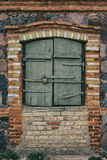 Wooden shutters on the window of an old stone house Royalty Free Stock Photos