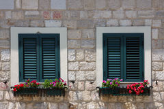 Wooden shutters on the windows Stock Image