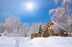Wooden Siberian house in winter snow Stock Image