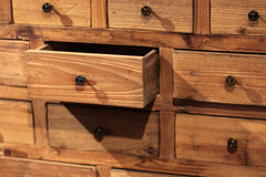 Wooden sideboard with small drawers Royalty Free Stock Photography