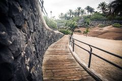 Wooden sidewalk and stonewall Royalty Free Stock Images