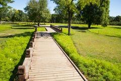 Wooden sidewalk, wooden railings Stock Images