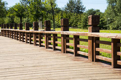 Wooden sidewalk, wooden railings Royalty Free Stock Photo