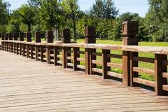 Wooden sidewalk, wooden railings Royalty Free Stock Photo
