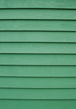 Wooden siding background. Painted timber cladding boards on a new house Royalty Free Stock Image