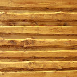 Wooden siding. Live edge board siding - spruce wood in oak rustical paint Stock Photos