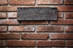 Wooden sign. On vintage brick wall Stock Images