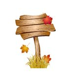 Wooden sign with autumn grass and leaves Stock Photography