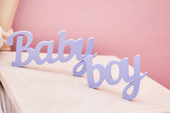 Wooden sign baby boy. On table Stock Photos
