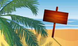 Wooden sign on the beach under the palm tree Stock Image