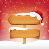 Wooden sign blank board and winter snow with copy space and Sant Stock Image