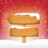 Wooden sign blank board and winter snow with copy space  Stock Photo