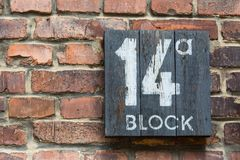 Wooden sign for block 14a in concentration camp Auschwitz royalty free stock images