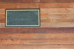Wooden sign board blank frame on wood wall Royalty Free Stock Photography