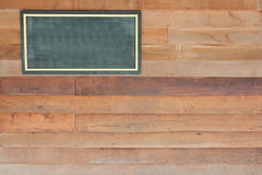 Wooden sign board blank frame on wood wall Royalty Free Stock Photos