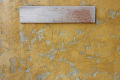 Wooden sign board on concrete wall Royalty Free Stock Images