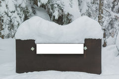 Wooden sign board, covered snow. Stock Photo