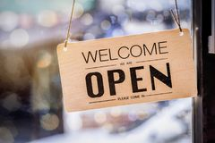 Wooden sign board hanging on door. Of cafe royalty free stock image