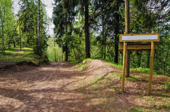 Wooden sign board on the natural trail Stock Photo