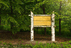 Wooden sign board ready to put information in the woods Royalty Free Stock Photo