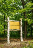 Wooden sign board in the woods Royalty Free Stock Images