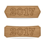 Wooden sign boards concept of new year of 2017 Stock Images