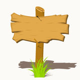 Wooden sign boards on a grass. Stock Photography
