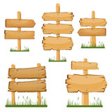 Wooden sign boards set. Vector cartoon wooden sign board on the grass. Royalty Free Stock Image