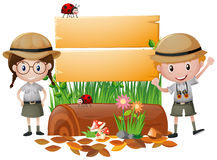 Wooden sign with boy and girl in safari outfit Stock Image