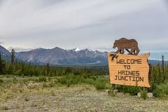 Wooden sign with carved bear welcomes visitors to Haines Junction stock photography