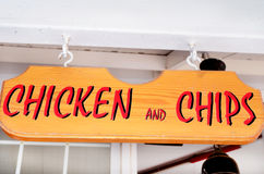 Wooden sign .chicken and chips Stock Photos