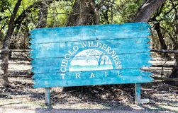 Wooden sign at the Cibolo Wilderness Trail in Texas. Weathered wooden sign welcoming visitors to  the Cibolo Wilderness Trail in Boerne, Texas Royalty Free Stock Photo