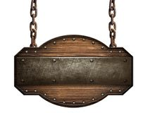 Wooden sign in a dark wood with iron strap and bolts hanging on chain  on white background Royalty Free Stock Photo