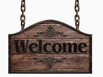 Wooden sign in a dark wood with the words welcome hanging on a chain isolated on white background. Used as a ready template for design Stock Photography
