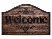 Wooden sign in a dark wood with the words welcome, isolated. On white background Royalty Free Stock Image