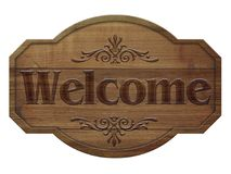 Wooden sign in a dark wood with the words welcome, isolated. On white background Stock Photos