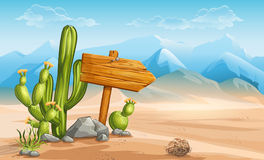 A wooden sign in the desert mountains in the background Stock Photos