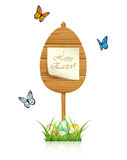 Wooden sign with Easter eggs Stock Image