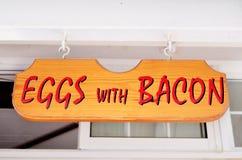 Wooden sign .Eggs with bacon Stock Photos