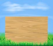 Wooden sign in field Stock Photo